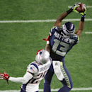 Seattle Seahawks wide receiver Chris Matthews (13) makes a catch against New England Patriots cornerback Kyle Arrington (25) during the second half of NFL Super Bowl XLIX football game Sunday, Feb. 1, 2015, in Glendale, Ariz The Associated Press