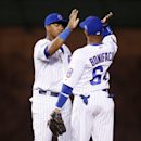 Chicago Cubs shortstop Starlin Castro, left, and second baseman Emilio Bonifacio, right, celebrate after they defeated the Arizona Diamondbacks 5-1 in a baseball game on Monday, April 21, 2014, in Chicago The Associated Press