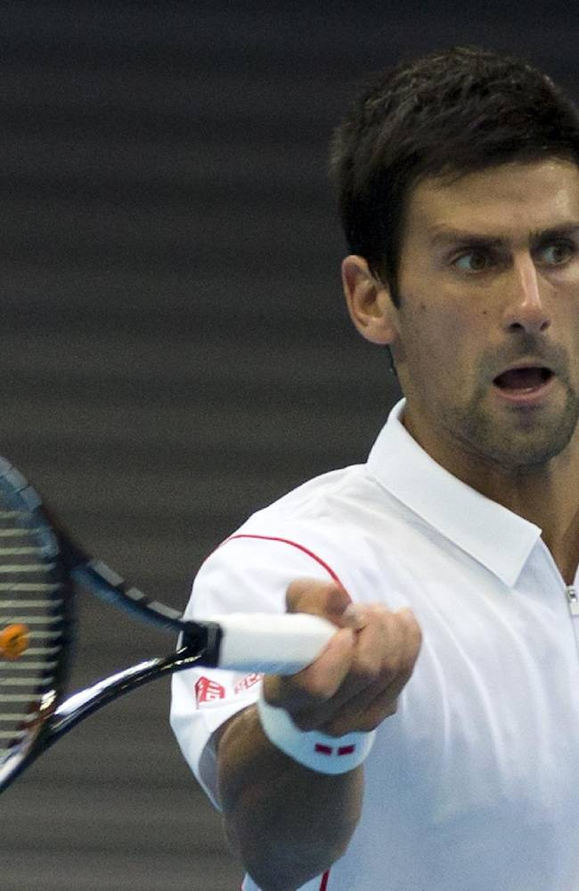 Novak Djokovic of Serbia returns a shot to Lukas Rosol of the Czech Republic during the China Open tennis tournament at the National Tennis Stadium in Beijing, China Tuesday, Oct. 1, 2013