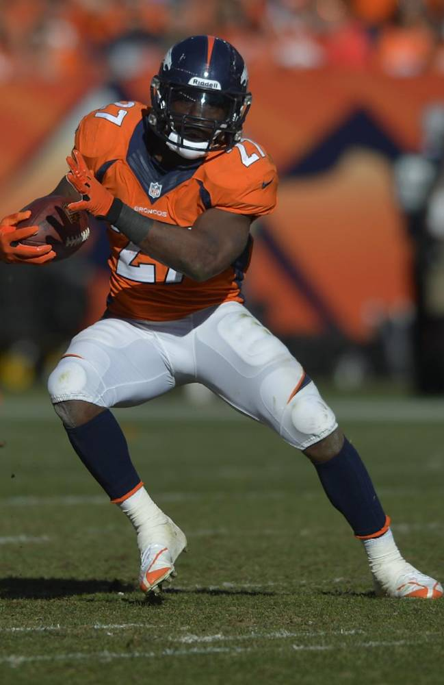 Denver Broncos running back Knowshon Moreno (27) carries the ball during the first half of the AFC Championship NFL playoff football game against the New England Patriots in Denver, Sunday, Jan. 19, 2014