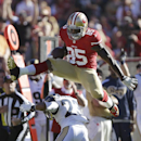 In this Dec. 1, 2013 file photo, San Francisco 49ers tight end Vernon Davis (85) jumps over St. Louis Rams free safety Rodney McLeod (23) during the first quarter of an NFL football game in San Francisco. Professional athletes frequently get traded to oth