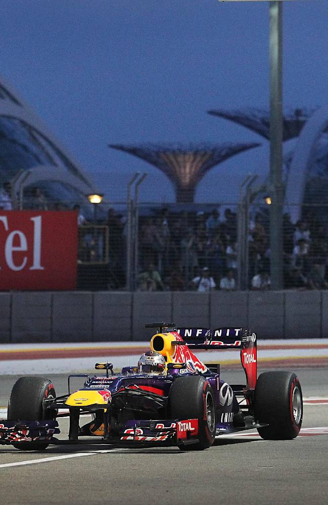 Red Bull driver Sebastian Vettel of Germany steers his car back into the pit during the third practice session for the Singapore Formula One Grand Prix on the Marina Bay City Circuit in Singapore, Saturday, Sept. 21, 2013