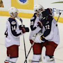 Columbus Blue Jackets right wing Blake Comeau (14) and Boone Jenner (38) congratulate goalie Sergei Bobrovsky (72), of Russia, after they defeated the Nashville Predators 1-0 in an NHL hockey game on Saturday, March 8, 2014, in Nashville, Tenn The Associa