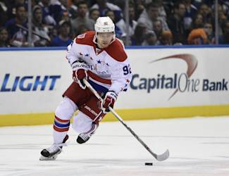 Washington Capitals center Evgeny Kuznetsov (92) drives the puck down ice in the first period of Game 6 of a first-round NHL Stanley Cup hockey playoffs against the New York Islanders at Nassau Coliseum on Saturday, April 25, 2015, in Uniondale, N.Y. (AP Photo/Kathy Kmonicek)