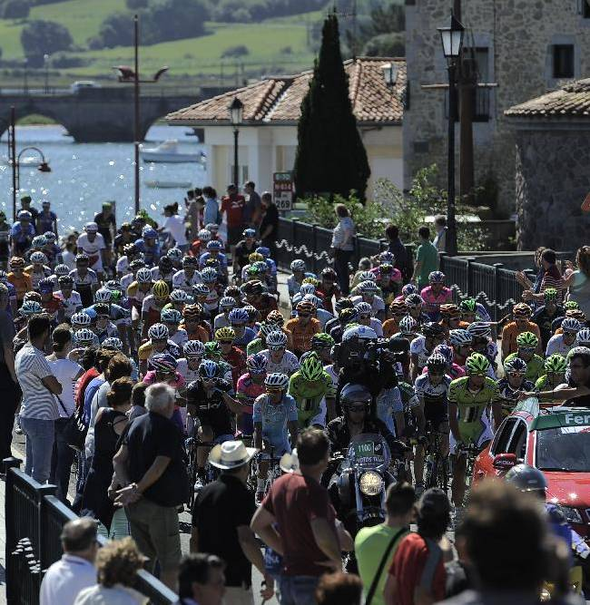 The pack of Spain's Vuelta  cross a bridge at the start of the 19th stage of the Vuelta cycling race, a 181-kilometer (112,5-mile) leg between San Vicente de La Barquera and Oviedo, in San Vicente de La Barquera, northern Spain, Friday, Sept. 13, 2013