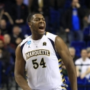 Marquette forward Davante Gardner (54) reacts after teammate Vander Blue scored the game winning basket in the final seconds of a second-round NCAA college basketball tournament game against the Davidson, Thursday, March 21, 2013, in Lexington, Ky. Marquette won 59-58. (AP Photo/James)
