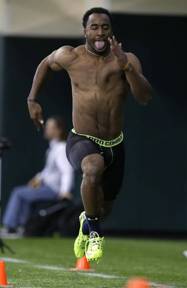 Baylor running back Lache Seastrunk runs the 40-yard dash during pro day for NFL football representatives on Wednesday, March 19, 2014, in Waco, Texas