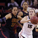 Oregon State's Jamie Weisner (15) looks for room to pass as Southern California's Kiki Alofaituli defends in the first half of the Pac-12 NCAA college championship basketball game Sunday, March 9, 2014, in Seattle. (AP Photo/Elaine Thompson)