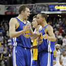 Golden State Warriors' David Lee, left, and Stephen Curry celebrate after beating the Sacramento Kings 115-113 in an NBA basketball game in Sacramento, Calif., Sunday, Dec. 1, 2013. Curry made two free throws with 8.6 seconds left The Associated Press
