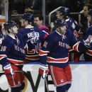 New York Rangers' Rick Nash (61) and Derick Brassard (16) celebrate with teammates after Nash scored a goal during the first period of an NHL hockey game against the Detroit Red Wings Wednesday, Nov. 5, 2014, in New York The Associated Press