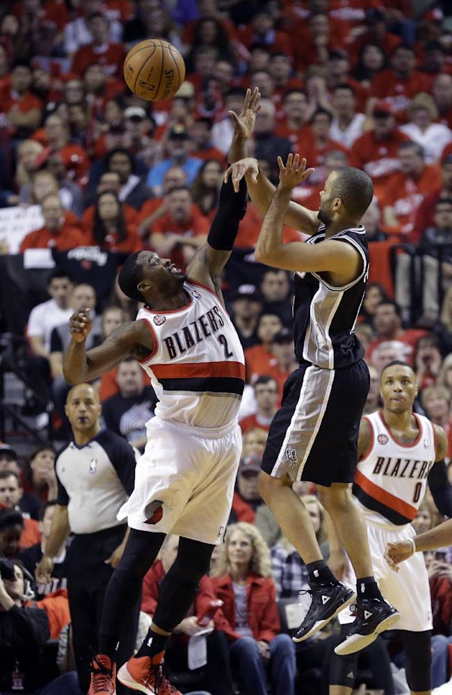 Portland Trail Blazers' Wesley Matthews (2) defends against San Antonio Spurs' Tony Parker (9) as he passes the ball in the first quarter of Game 3 of a Western Conference semifinal NBA basketball playoff series Saturday, May 10, 2014, in Portland, Ore