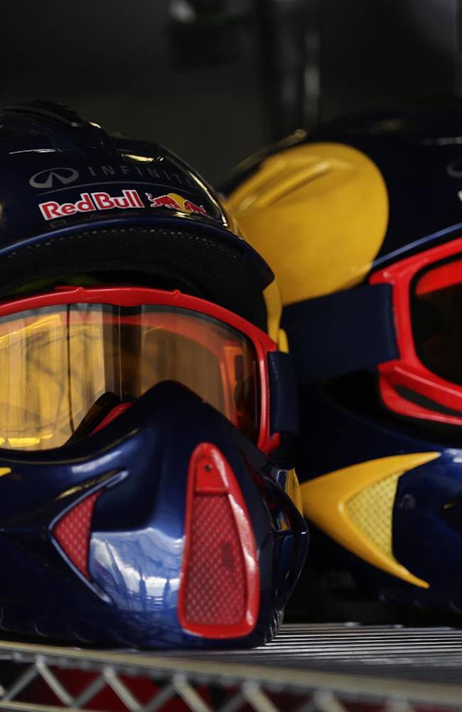 Helmets of the Red Bull pit crew sit on a shelf at pits during the third free practice at the Yas Marina racetrack in Abu Dhabi, United Arab Emirates, Saturday, Nov. 2, 2013