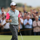 Rory McIlroy of Northern Ireland celebrates playing a birdie on the 9th green during the final round of the British Open Golf championship at the Royal Liverpool golf club, Hoylake, England, Sunday July 20, 2014