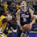 Connecticut's Stefanie Dolson (31) is fouled by Marquette's Sarina Simmons, left, during the first half of an NCAA college basketball game Saturday, Jan. 12, 2013, in Milwaukee. (AP Photo/Jeffrey Phelps)