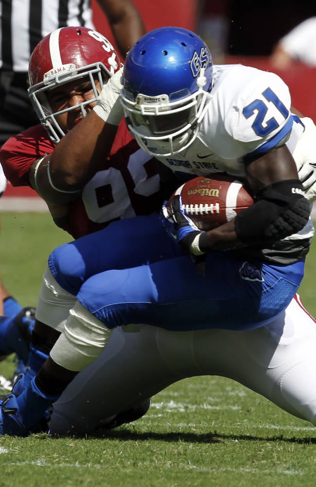 Alabama defensive lineman Brandon Ivory (99) tackles Georgia State running back Travis Evans (21) for a loss during the first half of an NCAA college football game on Saturday, Oct. 5, 2013, in Tuscaloosa, Ala