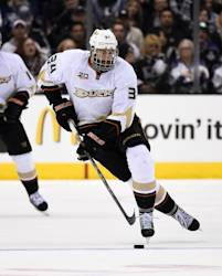 Anaheim Ducks right wing Daniel Winnik moves the puck during the third period of an NHL hockey game against the Los Angeles Kings, Saturday, April 12, 2014, in Los Angeles.  (AP Photo/Mark J. Terrill)