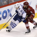 Toronto Maple Leafs left wing James Van Riemsdyk (21) shields Arizona Coyotes defenseman Keith Yandle (3) from the puck during the third period during an NHL hockey game, Tuesday, Nov. 4, 2014, in Glendale, Ariz. The Coyotes won 3-2 The Associated Press