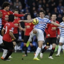 Queens Park Rangers' Joey Barton, center, clears the ball during the English Premier League soccer match between QPR and Manchester United at Loftus Road stadium in London, Saturday, Jan. 17, 2015