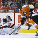 Philadelphia Flyers' Wayne Simmonds (17) cannot get a shot past New Jersey Devils' Martin Brodeur (30) as Andy Greene (6) looks on during the third period of an NHL hockey game, Tuesday, March 11, 2014, in Philadelphia. New Jersey won 2-1. (AP Photo/Matt Slocum)