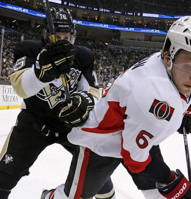 Ottawa Senators' Bobby Ryan (6) battles for the puck in the corner against Pittsburgh Penguins' Brandon Sutter in the second period of an NHL hockey game in Pittsburgh, Monday, Feb. 3, 2014