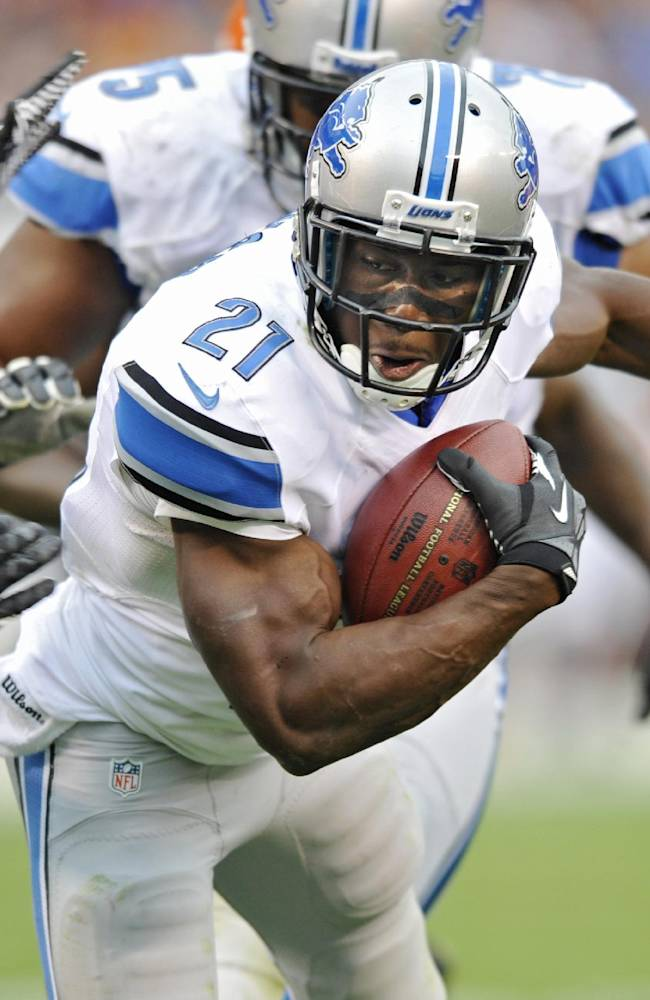 In this Oct. 13, 2013 file photo, Detroit Lions running back Reggie Bush (21) runs a pass reception 18 yards for a touchdown against the Cleveland Browns in the third quarter of an NFL football game in Cleveland. Bush has scored four times, run for at least 78 yards and averaged almost five receptions in Detroit's five wins