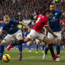 Manchester United's Radamel Falcao, center, fights for the ball against Leicester's Ritchie De Laet, left, and Danny Simpson during the English Premier League soccer match between Manchester United and Leicester at Old Trafford Stadium, Manchester, Englan