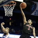 Louisville guard Peyton Siva, right, drives to the basket as DePaul guard Brandon Young watches during the first half of an NCAA college basketball game in Rosemont, Ill., on Wednesday, Feb. 27, 2013. (AP Photo/Nam Y. Huh)