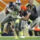 Team Carter DE J.J. Watt from the Texans returns an interception while tackled by Team Irvin tackle Joe Thomas of the Cleveland Browns during the Pro Bowl at University of Phoenix Stadium in Glendale, Ariz., Sunday, Jan. 25, 2015, Ariz The Associated Pres