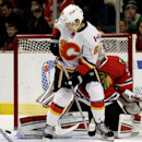 Calgary Flames center Dennis Wideman (6) passes the puck by Chicago Blackhawks goalie Antti Raanta (31) during the first period of an NHL hockey game in Chicago, Sunday, Dec. 14, 2014 The Associated Press