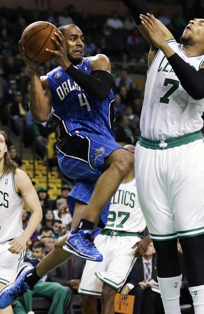 Orlando Magic shooting guard Arron Afflalo (4) looks to pass as he is pressured by Boston Celtics power forward Jared Sullinger (7) during the second half of an NBA basketball game, in Boston, Monday, Nov. 11, 2013. The Celtics defeated the Magic 120-105