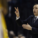 Indiana Pacers coach Frank Vogel calls a play against the Atlanta Hawks during the first half in Game 5 of an opening-round NBA basketball playoff series Monday, April 28, 2014, in Indianapolis. (AP Photo/Darron Cummings)