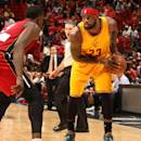 MIAMI, FL - DECEMBER 25: LeBron James #23 of the Cleveland Cavaliers handles the basketball against Luol Deng #9 of the Miami Heat at the American Airlines Arena on December 25, 2014 in Miami, Florida. (Photo by Issac Baldizon/NBAE via Getty Images)