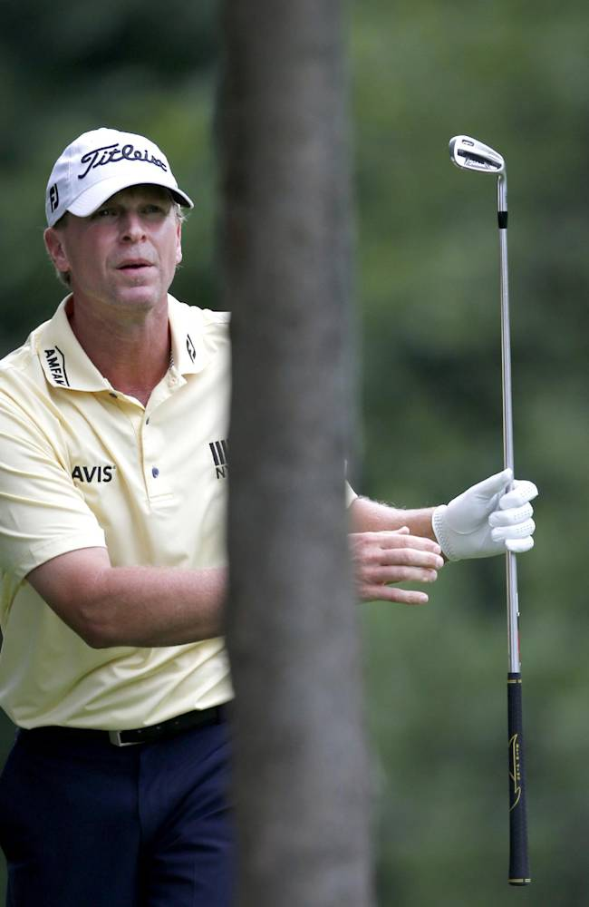 Steve Stricker watches his approach shot on the sixth hole during the third round of the 2014 John Deere Classic golf tournament at TPC Deere Run in Silvis, Ill., Saturday, July 12, 2014