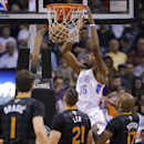 Phoenix Suns' Goran Dragic (1), of Slovenia, Alex Len (21), and P.J. Tucker (17) watch Oklahoma City Thunder forward Kevin Durant dunk during the second half of an NBA basketball game, Thursday, March 6, 2014, in Phoenix The Associated Press