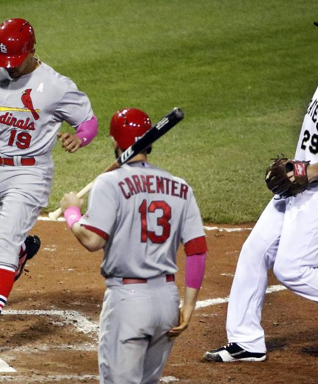 St. Louis Cardinals' Jon Jay (19) scores on a wild pitch by Pittsburgh Pirates relief pitcher Bryan Morris (29) during the eighth inning of a baseball game in Pittsburgh Sunday, May 11, 2014. It proved to be the winning run in a 6-5 Cardinals win