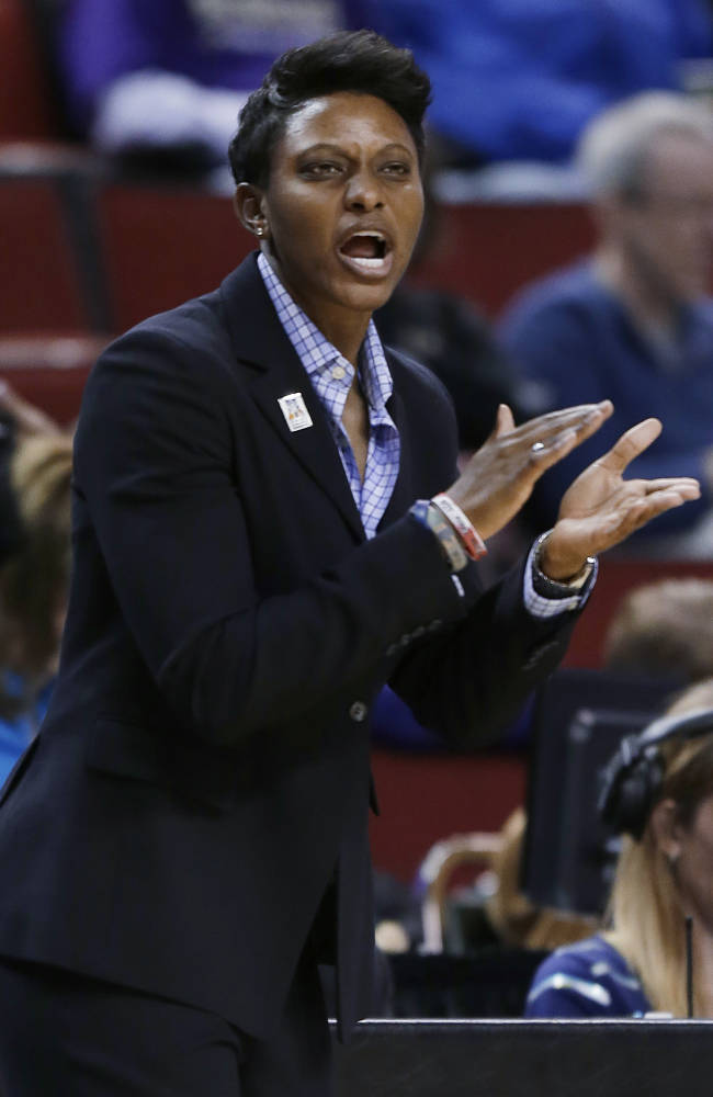 Arizona coach Niya Butts calls to her team during the first half of an NCAA college basketball game against Utah in the Pac-12 Conference tournament, Thursday, March 7, 2013, in Seattle. Utah won 66-48