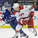 Carolina Hurricanes center Elias Lindholm (16) breaks out after getting past Tampa Bay Lightning right wing Ryan Callahan (24) during the first period of an NHL hockey game Thursday, Dec. 11, 2014, in Tampa, Fla The Associated Press