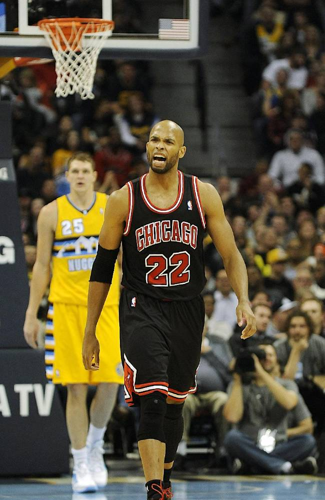 Chicago Bulls forward Taj Gibson complains about a foul call in the second half of an NBA basketball game between the Chicago Bulls and the Denver Nuggets on Thursday, Nov. 21, 2013, in Denver. Gibson was ejected later in the game after garnering his second technical foul. The Nuggets won 97-87