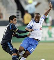 Philadelphia Union's Josue Martinez, left, shoves Montreal Impact's Collen Warner away from the ball in the first half of an MLS soccer match, Saturday, July 14, 2012, in Chester, Pa. (AP Photo/Matt Slocum)