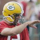 Green Bay Packers' Aaron Rodgers gestures to teammates during NFL football training camp on Saturday, July 26, 2014, in Green Bay, Wis The Associated Press