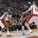 Sacramento Kings' Rudy Gay, center, drives between Toronto Raptors' Kyle Lowry, left, and Tyler Hansbrough during first half NBA basketball action in Toronto on Friday March 7 , 2014 The Associated Press