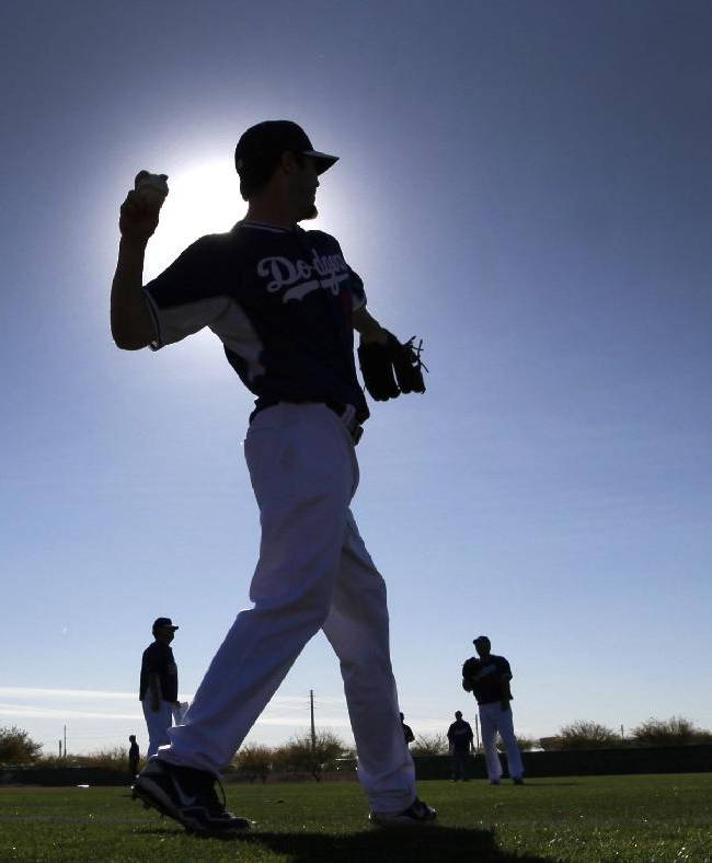 Los Angeles Dodgers pitcher Dan Haren throws during spring training baseball practice Tuesday, Feb. 11, 2014, in Glendale, Ariz