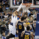 Dallas Mavericks forward Shawn Marion, left, dunks the ball as Utah Jazz Enes Kanter (0) and Derrick Favors (15) defend during the first half of an NBA basketball game on Friday, Nov. 22, 2013, in Dallas The Associated Press