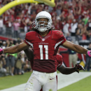 Arizona Cardinals wide receiver Larry Fitzgerald (11) celebrates his touchdown against the Washington Redskins during the first half of an NFL football game, Sunday, Oct. 12, 2014, in Glendale, Ariz The Associated Press