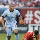 Manchester City's Fernando gains control of the ball as Liverpool's Philippe Coutinho (10) falls down in the first half of a Guinness International Champions Cup soccer tournament match Wednesday, July 30, 2014, in New York