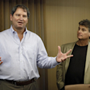 FILE - In this Jan. 10, 2013 file photo, former Cleveland Browns quarterback Bernie Kosar, left, speaks at a news conference with Dr. Rick Sponaugle, in Middleburg Heights, Ohio . Thursday, Jan. 10, 2013. Kosar believes he's been unfairly sacked as a TV broadcaster. Kosar contends he's been removed because of slurred speech he attributes to