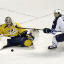 Nashville Predators goalie Pekka Rinne (35), of Finland, blocks a shot as Winnipeg Jets left wing Adam Lowry (17) closes in during the first period of an NHL hockey game Saturday, Nov. 15, 2014, in Nashville, Tenn The Associated Press