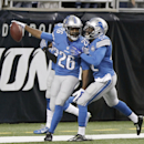 Detroit Lions strong safety Don Carey (26) is congratulated by strong safety Isa Abdul-Quddus after his 40-yard fumble recovery for a touchdown during the first half of an NFL football game against the Green Bay Packers in Detroit, Sunday, Sept. 21, 2014. (AP Photo/Duane Burleson)