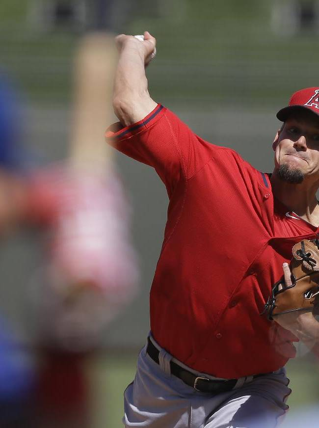 Los Angeles Angels starting pitcher Joe Blanton throws during the second inning of a spring exhibition baseball game against the Texas Rangers Wednesday, March 12, 2014, in Surprise, Ariz
