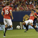 Paris Saint-Germain's Maxwell, right ,battles for the ball with Manchester United's Memphis Depay during International Champions Cup Play in Chicago, Wednesday, July 29, 2015. (AJ Mast / AP Images for International Champions Cup)